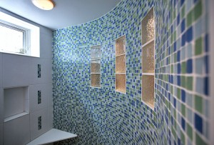 green bath remodel with curved shower wall