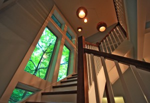 Green remodeling benefits: an open staircase design and natural daylighting reduce need for electric lights
